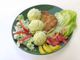 dinner dish with pork cutlet and vegetables poster