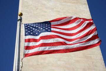 american flag and washington monument
