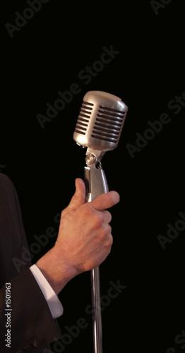 Leinwandbild Motiv singer holding vintage microphone & stand