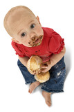 baby eating muffins
