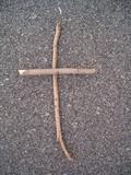simple cross against bitumen background poster