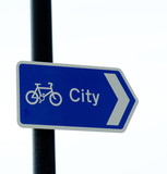 cycle way sign pointing towards city on white back poster