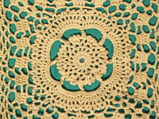 hand crocheted lace with green background