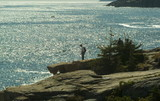 hiker on the cliffs in acadia national park poster