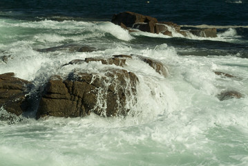 large crashing waves on boulders