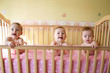 baby girls in crib - triplets