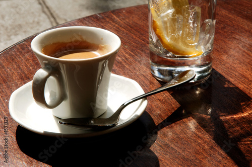 paris: coffee at the terrace in the morning sun