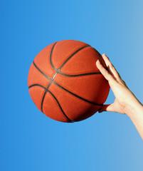 palming a basketball
