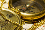 old style gold compass & calendar on closeup poster