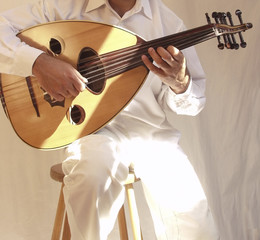 arab musician playing traditional stringed instrum