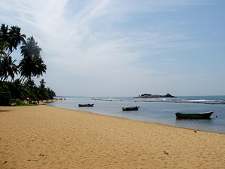 sandy beach with fishing boats