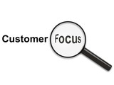 magnifying glass on customer focus poster