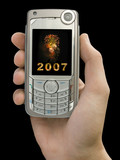 2007 and fireworks on display of mobile phone in hand poster