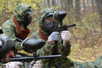 game in paintball in a forest.