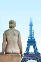 woman statue and eiffel tower