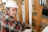 plumber working in toilet tank poster