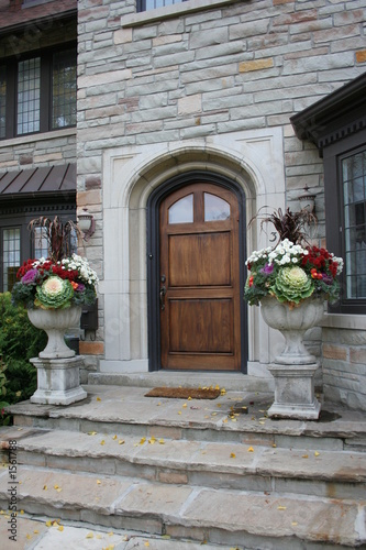 front steps with fall flowers
