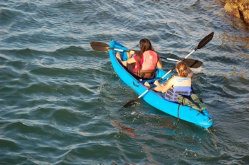 girls in a blue kayak