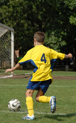 boy playing soccer