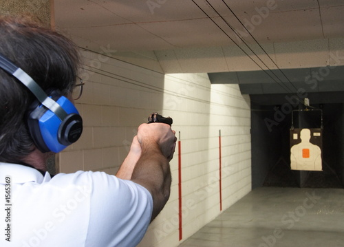 man shooting handgun
