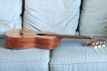broken guitar on the couch