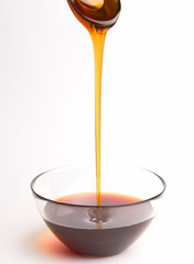 honey pouring from the spoon