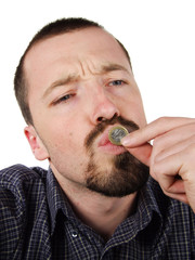 young male kissing a 1 euro coin
