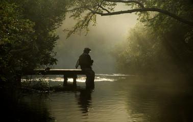 misty river fisherman