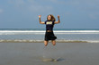 jumping girl on the beach