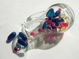 small glass pitcher full of medicines poster