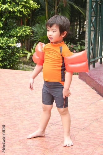 boy with swimming costume