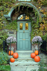 front door with ivy and pumpkins