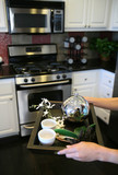 tea in the kitchen (narrow focus on tea kettle) poster