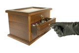 hand in black glove opening casket with jewelry poster