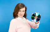 young woman holding compact disc poster