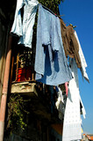 portugal, porto: clothes at the window in ribeira district poster