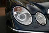 headlamp of expensive car poster