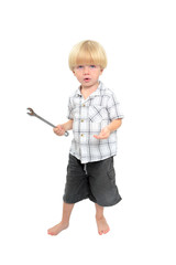 isolated shot of young boy playing with large spanner