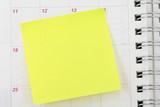 blank notepaper sticking on calendar poster