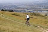 mountain biker on hill poster
