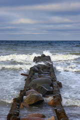 stone breakwater in winter