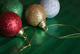 four shiny christmas balls poster