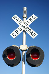 railroad crossing sign with lamps