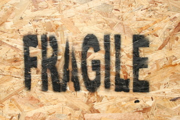 fragile stenciled onto chipboard