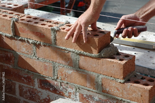 Fotobehang Wand bricklayer