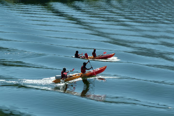 kayaking on blue waters on the river