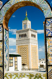 mosque tower - framed with ornamental arch in tuni poster