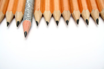 celebratory pencil among usual pencils from top