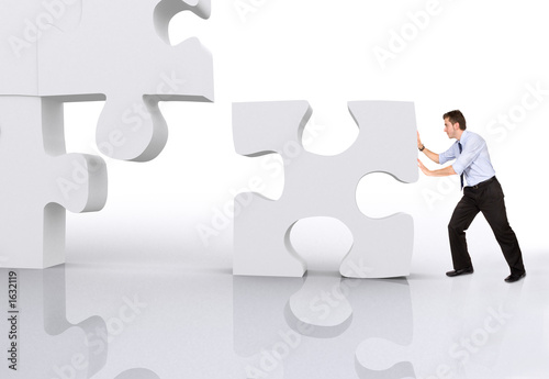 business man building a puzzle