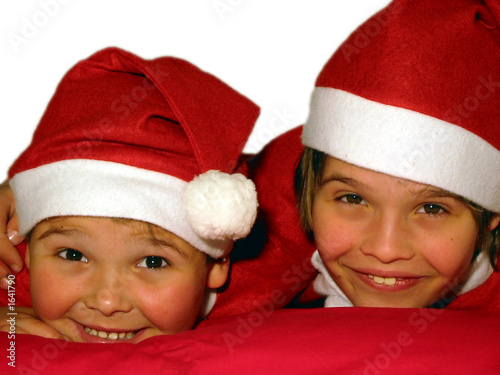 two lovely boys with red christmas hats